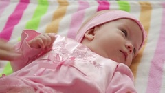 One-year-old girl in a pink dress Stock Footage
