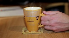 Man's Hand is in The Frame, Which Takes a Cup of Coffee at Home Stock Footage