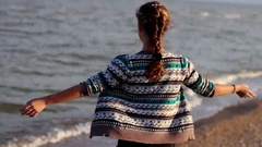 A Girl Stands on The Shore of The Azov Sea in Ukraine Stock Footage