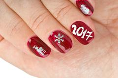 Finger nail with christmas pattern Stock Photos
