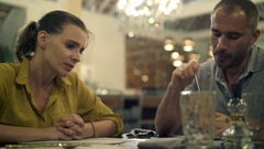 Young sad couple talking and drinking coffee in cafe Stock Footage