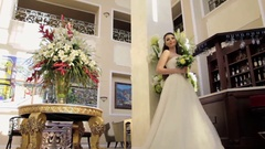 Bride standing in the extensive hall Stock Footage