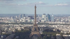 Eiffel tower in the heart of Paris city, modern buildings in background Stock Footage