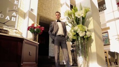 Man standing in the extensive hall Stock Footage