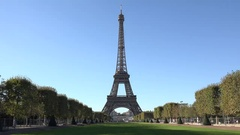 Eiffel tower and green alley, blue serene sky, beautiful romantic french day  Stock Footage