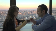 Romantic couple enjoy champagne on hotel terrace, up city view, splendid evening Stock Footage