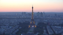 Light Eiffel tower in the Paris city heart, colored evening sky Stock Footage