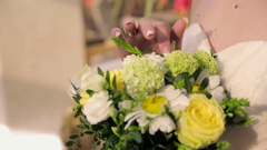 Hands holding a bouquet Stock Footage