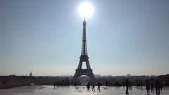 Sun shinning over Eiffel tower, morning light Stock Footage