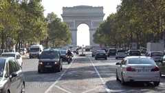 Arc de Triomphe, Arch of Triumph, car passing, trees alley Stock Footage