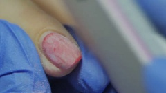 Manicurist removing the old gel polish using nail file Stock Footage