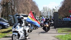 Russian motorcyclists departs from the cemetery of Soviet Soldiers in Poland Stock Footage