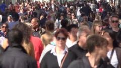 Many pedestrian passing on crowdy street, modern sidewalk  Stock Footage