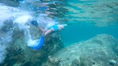 Young man snorkeling underwater in Virgin Gorda Stock Footage