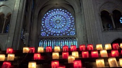 Nostre Dame de Paris interior, beautiful stained glass and candles ligtning Stock Footage