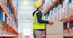Warehouse worker suffering from back pain while working Stock Footage