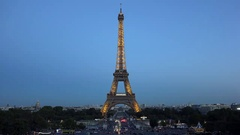 Illuminated Eiffel tower and blue evening sky, romantic city symbol Stock Footage