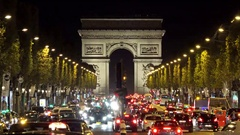 Many cars on night crowded street of Arc de Triomphe, Arch of Triumph Paris city Stock Footage