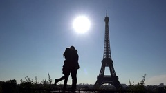 Young woman and man silhouette dating, sun shinning, love close Eiffel tower Stock Footage