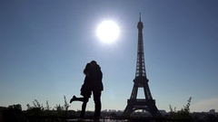 Couple silhouette dating at Eiffel tower, shinning morning sun Stock Footage