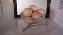 Dangerous cooking eggs in the shell in a microwave oven Stock Footage