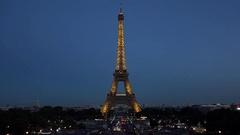 Beautiful illuminated Eiffel tower, romantic tourism Stock Footage