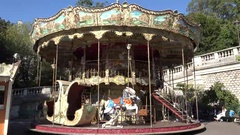 Carousel rotating in a sunny day Stock Footage