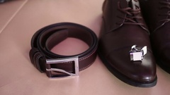 Belt, cuffinks and brown shoes Stock Footage