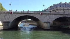 Beautiful cruise on Seine river passing close Notre Damme de Paris Stock Footage