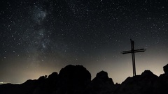 Time lapse of stars moving in night sky over cross of Jesus Christ. Dolly shot Stock Footage