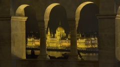 Hungarian Parliament seen from Fisherman's Bastion in Budapest at night Stock Footage