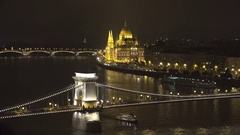 Hungarian Parliament and Széchenyi Chain Bridge over Danube river in Budapest Stock Footage