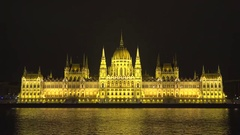 Night view of Hungarian Parliament mirrored in Danube river, Budapest Stock Footage