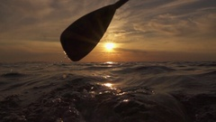 SLOW MOTION CLOSE UP: Detail of pushing paddle blade through glossy ocean water Stock Footage