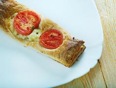 Pastry tart with cheese and tomatoes Stock Photos
