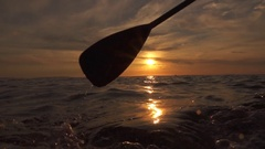 SLOW MOTION CLOSE UP: Sea bubbling when pushing paddle blade through ocean water Stock Footage