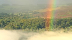 Raising Mist and Rainbow over British Countryside Landscape Stock Footage