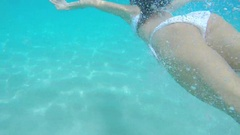 Beautiful woman swimming underwater on paradise beach freedom wellbeing Stock Footage