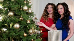 Happy New Year, happy girls in evening dresses talk, laugh during Decorating a Stock Footage