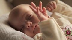 The newborn girl sleeping in crib Stock Footage