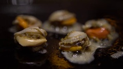 4K Cuisine Sea Food. Chef cooking a Grilling Clams on grilled in restaurant-Dan Stock Footage