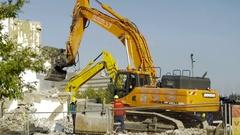 Excavator working on demolition site - 4K Stock Footage