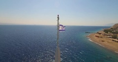 From Israeli flag to long shot of the Underwater Observatory in Eilat  Stock Footage