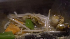 Slow Motion Cuisine Sea Food. Chef cook a Clams with vegetables on grilled-Dan Stock Footage