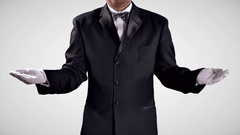 4K Tuxedo Man with Open Hands, Black and White Uniform, Open Hands, Palm Up Stock Footage
