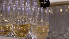 Close-up of bottle. In glasses pour champagne from a bottle. From a bottle pour Stock Footage