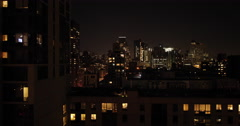 New York City buildings at night dolly aerial Stock Footage