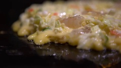 4K Okonomiyaki Japanese food. Cooking Monjayaki Fried in Japan restaurant-Dan Stock Footage
