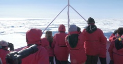 Expedition to the arctic standing on deck of a ship Stock Footage