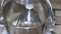 Industrial mixer whipping marshmallow mixture at confectionery factory Stock Footage